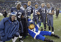 December 21, 2008:  Seattle Seahawks (left to right) #5 Charlie Frye, #23 Marcus Trufant, #83 Deion Branch, #82 Jordan Kent,  #15 Seneca Wallace,  #51 Lofa Tatupu, #84 Bobby Engram and Seahawks mascot Blitz pose for a photo after the game against NY Jets at Quest Field in Seattle, WA.  Seattle won 13-3 over the NY Jets.