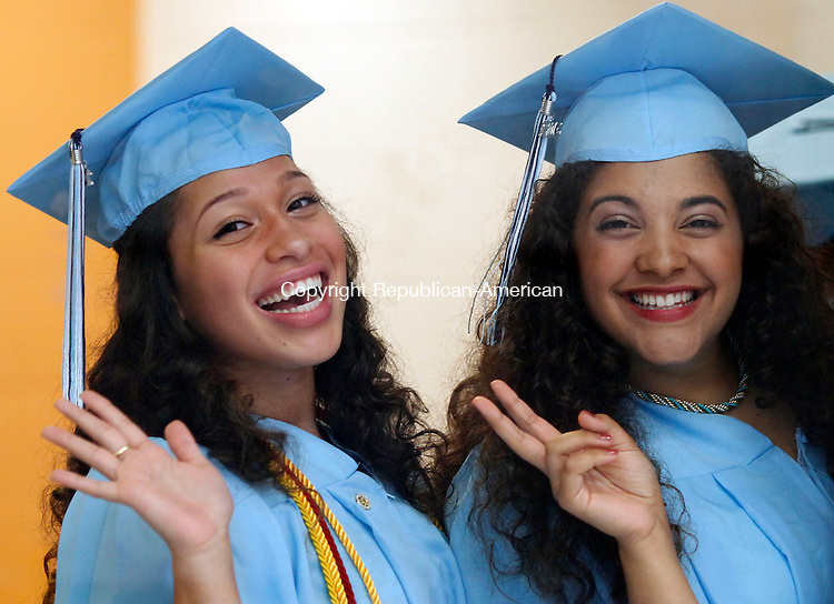 Oxford, CT- 21 June 2013-062113CM04- Jackie Ortiz, left and Ally Caple show their enthusiasm before the start of commencement exercises at Oxford High School Friday night.  Christopher Massa Republican-American