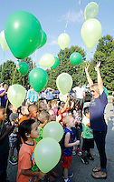 NWA Democrat-Gazette/DAVID GOTTSCHALK  Jill Jackson, kindergarten teacher at Asbell Elementary School in Fayetteville, participates in a balloon release Friday, August 7, 2015 with her class. Three classes of kindergarten students participated in the annual release marking the launch of their academic careers.
