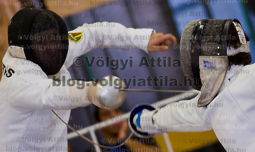 Robert Nemeth from Hungary scores a point during the fencing event of the mens pentathlon world cup.
