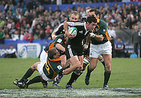 New Zealand centre Ryan Crotty is tackled by Stefan Watermeyer and Francois Brummer during the U19 Championship final against South Africa at Ravenhill, Belfast.