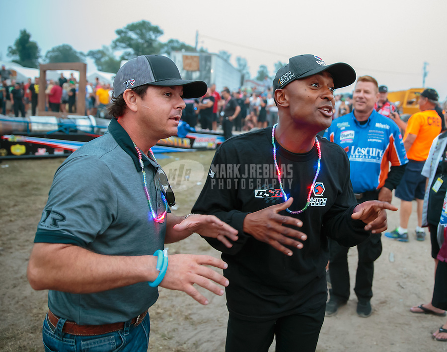 Aug 18, 2018; Brainerd, MN, USA; NHRA top fuel driver Steve Torrence (left) and Antron Brown during qualifying for the Lucas Oil Nationals at Brainerd International Raceway. Mandatory Credit: Mark J. Rebilas-USA TODAY Sports