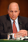 John D. Negroponte, United States Representative to the United Nations, U.S. Mission to the United Nations, New York, NY testifies at a hearing of the United States Senate Foreign Relations Committee to review the United Nations Oil-for-Food Program in Washington, D.C. on April 7, 2004..Credit: Ron Sachs / CNP.