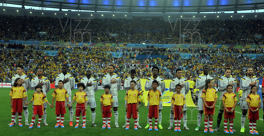 RIO DE JANEIRO - BRASIL -28-06-2014. Jugadores de Colombia (COL) durante los actos protocolarios previo al partido de los octavos de final con Uruguay (URU) por la Copa Mundial de la FIFA Brasil 2014 jugado en el estadio Maracaná de Río de Janeiro./ Players of Colombia (COL) during the formal events prior of the match of the Round of 16 against Uruguay (URU)  for the 2014 FIFA World Cup Brazil played at Maracana stadium in Rio do Janeiro. Photo: VizzorImage / Alfredo Gutiérrez / Contribuidor