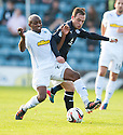 Morton's Fouad Bachirou and Dundee's Carlo Monti challenge for the ball.