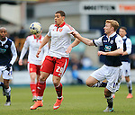 Millwall's Christ Taylor tussles with Sheffield United's Che Adams during the League One match at The Den.  Photo credit should read: David Klein/Sportimage