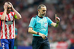Referee Cuneyt Cakir  (r) and Atletico de Madrid's Diego Godin during Champions League 2017/2018, Group C, match 2. September 27,2017. (ALTERPHOTOS/Acero)