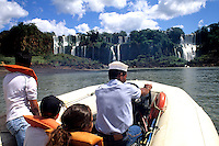 Iguassu Falls riding on boat under the falls on the Argentina side one of the worlds best falls .