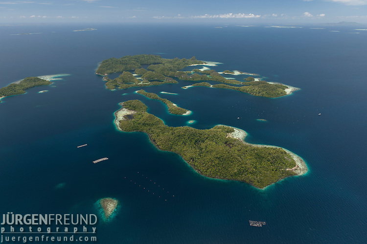 Aerial of Raja Ampat's islands, sand cays and lagoons. A pearl farm operates in these waters