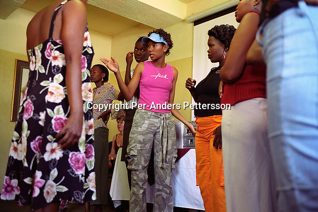 GABORONE, BOTSWANA - FEBRUARY 24: Juby Peacock, age 20, the current Miss Botswana gives catwalk instructions to participants a few days before the Miss HIV Stigma Free Botswana competition held annually in the international convention center on February 25, 2005 in Gaborone, Botswana. Twelve HIV positive women selected from around the country were trained how to walk, make a speech during an intense week of preparations. The pageant is held to make the people of Botswana more aware of HIV-Aids, and stop the stigma that makes people afraid of being tested and acknowledge their status. Botswana has a population of about 1,7 million people and about 38 percent are believed to be infected with the virus..(Photo: Per-Anders Pettersson/Getty Images).