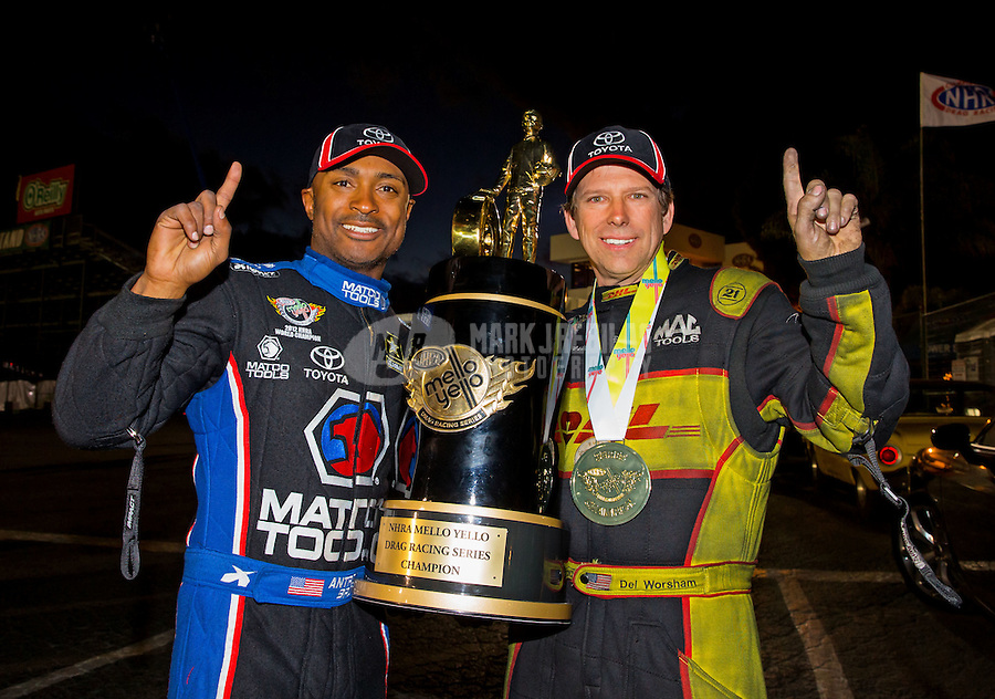 Nov 15, 2015; Pomona, CA, USA; NHRA funny car champion Del Worsham (right) and top fuel champion Antron Brown pose for a photo as they celebrate after winning the Auto Club Finals at Auto Club Raceway at Pomona. Mandatory Credit: Mark J. Rebilas-USA TODAY Sports