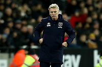 29th January 2020; London Stadium, London, England; English Premier League Football, West Ham United versus Liverpool; West Ham United Manager David Moyes looks on anxiously as his team lags behind