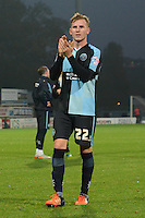Wycombe Wanderers Jason McCarthy thanks the travelling supporters following the Sky Bet League 2 match between Mansfield Town and Wycombe Wanderers at the One Call Stadium, Mansfield, England on 31 October 2015. Photo by Garry Griffiths.