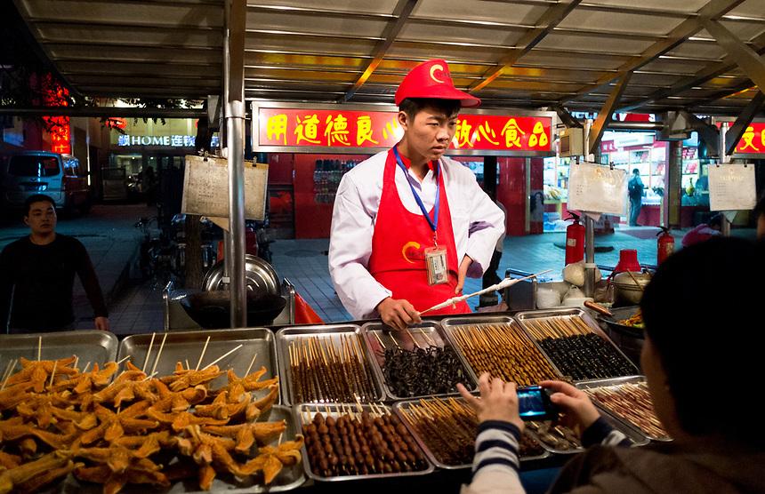 BEIJING,CHINA: October 12, 2012. Beijing travel.<br /> Dong Hua Men Night Market, food and starfish on skewers