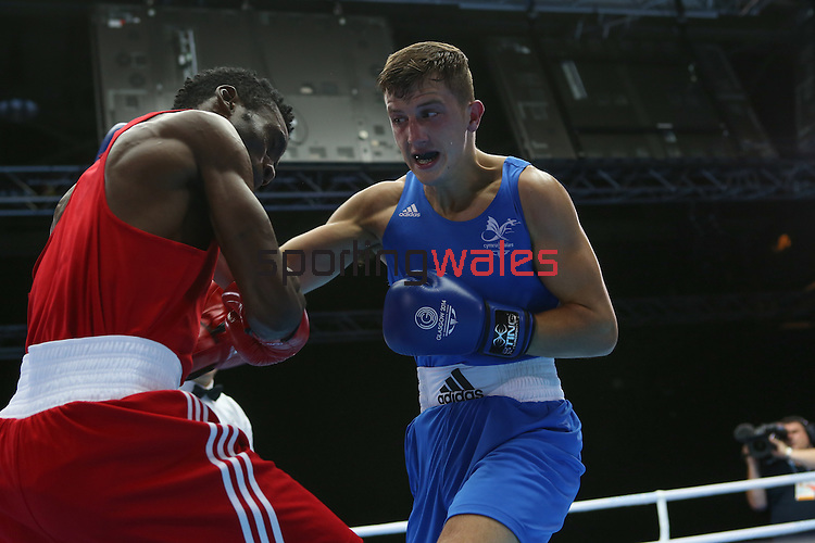 Glasgow 2014 Commonwealth Games<br /> Men's Light Welter (64kg)<br /> Zack Davies, Wales (Blue) v Waheed Shogbamu, Nigeria (Red)<br /> 27.07.14<br /> ©Steve Pope-SPORTINGWALES