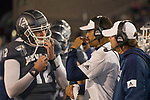 Nevada head coach Jay Norvell talks with quarterback Carson Strong (12) in the second half of an NCAA college football game against New Mexico in Reno, Nev., Saturday, Nov. 2, 2019. (AP Photo/Tom R. Smedes)