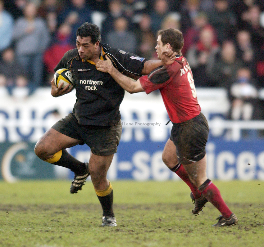 Photo. Jed Wee.Newcastle Falcons v Saracens, Parker Pen Challenge Cup, Kingston Park, Newcastle. 19/01/2003..Newcastle's Epi Taione holds off Saracens' Kyran Bracken.