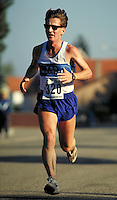 35 year old male runner during 1 2 marathon road race, racing, races, competition, endurance, men, man; MR#2031; restrictions may be waived--contact photographer.