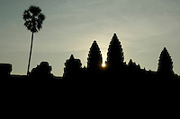 The first rays of sunlight at the temple towers of Angkor Wat, Cambodia, Siem Reap