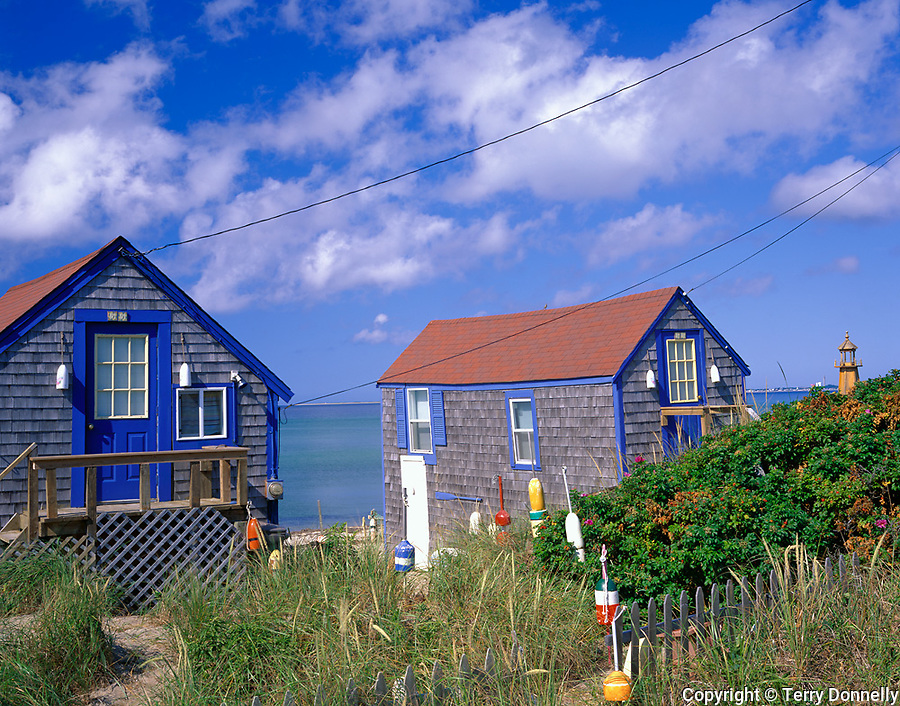 Cape Cod National Seashore, MA<br /> Pair of restored fishing shacks with decorative lobster bouys - on the beach at Cape Cod Bay near Truro