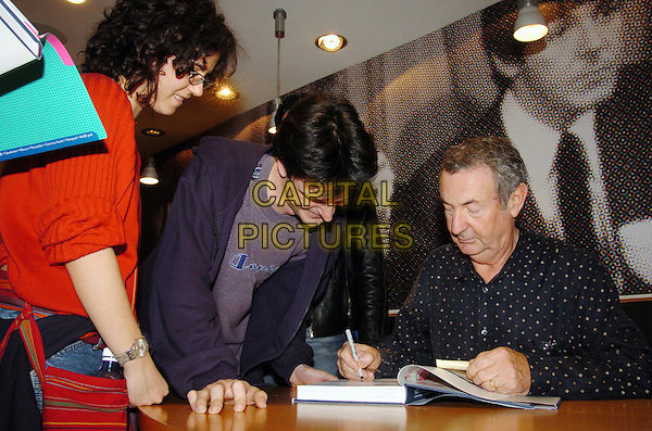 "NICK MASON - PINK FLOYD.With his book ""Inside Out-The first Pink Floyd biogarphy"".April 27th, 2005.half length signing autographs drummer.www.capitalpictures.com.sales@capitalpictures.com.© Capital Pictures."