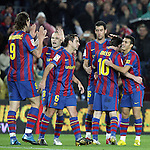 Football Season 2009-2010. Barcelona's players celebrating Lionel Messi's first goal during their spanish liga soccer match at Camp Nou stadium in Barcelona. January 16, 2010.