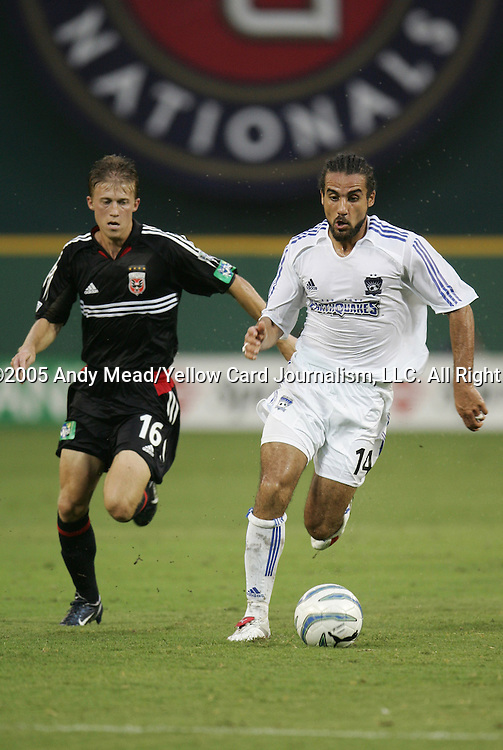15 July 2005: Dwayne DeRosario (14) is chased by Brian Carroll (16). DC United defeated the San Jose Earthquakes 3-0 at RFK Stadium in Washington, DC in a regular season Major League Soccer game.
