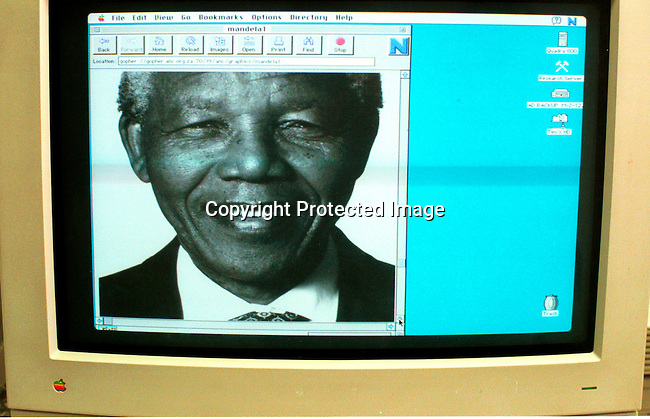 dipeman00482.Former President Nelson Mandela of South Africa smiling as he's on the webpage for the ANC (African national congress) on 20 March, 1997 in Cape Town, South Africa. The ANC freedom fighter was in prison for 27 years and released in 1990 after the unbanning of the ANC. He became President of South Africa after the first multiracial democratic elections in April 1994. Mr Mandela retired after one term in 1999 and gave the leadership to the current president Mr Thabo Mbeki..©Per-Anders Pettersson/ iAfrika Photos