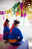 Mongolian bride and bridegroom in national costume wait for a traditional wedding ceremony in Damao Banner, Inner Mongolia, China, October 2014.