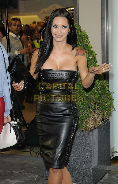 Jessica Jane Stafford<br /> attended the Celeb Boutique store launch party, Celeb Boutique, Westfield Stratford  City, London, England, UK, 25th July 2013.<br /> half length  strapless black dress leather studded clutch bag hand tattoo rose on shoulder <br /> CAP/CAN<br /> &copy;Can Nguyen/Capital Pictures