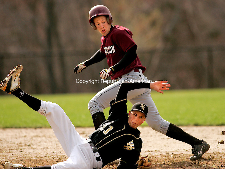 BEACON FALLS, CT- 25 APRIL 2005-042505JS02--Woodland Regional's Ken Graveline dives for an errant throw while trying to pick off Torrington's David Nole at second base Monday in Beacon Falls.  --- Jim Shannon Photo--Torrington; Woodland Regional High School; Ken Graveline, David Nole, Beacon Falls are CQ