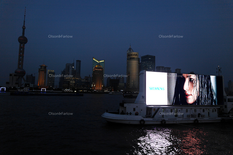 Scenes from the Bund... Including giant illuminated screen that shows commercials as it motors up and down the river.