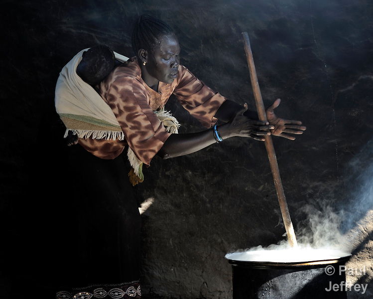 A woman cooking lunch for students in a school in Yei, Southern Sudan, sponsored by the United Methodist Church. NOTE: In July 2011 Southern Sudan became the independent country of South Sudan.
