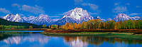 937000021 panoramic dawn light on the teton range at the oxbow bend of the snake river on an autumn morning with fall colored aspens in grand tetons national park wyoming