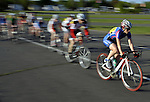 Cyclist Giulia Righi, of New Britain, foreground, a long with other cyclist in a blur, on the course during the first race during the Tuesday Training Races, May 16, 2013, at Rentchler Field in East Hartford.  The U.S. Cycle Event is open to anyone, there also a junior division staring as young as 13,  a fee is required to enter. Some 66 riders participating in two races on this the first night of their season. Riders ran in a circle course in the lot in front of the stadium. The Capital Velo Club  based in Glastonbury is the group that runs the event and has been racing at the Rent for approximately the past eight years. that races start at 6 PM and end around 8 PM and run through August 20.  http://capitalveloclub.com/tuesday-the-rent/ic0z4213_std/     (Jim Michaud / Journal Inquirer)