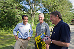 Matt Dunne (left) and Peter Galbraith (right) speak with a voter at the Jamaica Vemont Old Home Day celebration in 2010