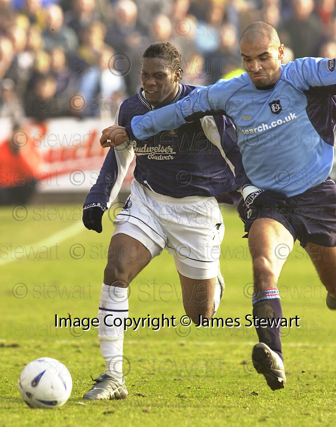 22/03/2003                   Copright Pic : James Stewart.File Name : stewart-falkirk v dundee 08.COLLIN SAMUEL AND SONAY HERNANDEZ CHALLENGE FOR THE BALL.........James Stewart Photo Agency, 19 Carronlea Drive, Falkirk. FK2 8DN      Vat Reg No. 607 6932 25.Office     : +44 (0)1324 570906     .Mobile  : +44 (0)7721 416997.Fax         :  +44 (0)1324 570906.E-mail  :  jim@jspa.co.uk.If you require further information then contact Jim Stewart on any of the numbers above.........