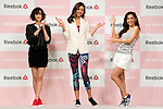 """(L to R) A guest model and Reebok classic ambassador Tina Tamashiro, the Australian model Miranda Kerr and the fashion model Anne Nakamura pose for the cameras during the Reebok Skyscape Fashion Show on April 15, 2015, Tokyo, Japan. Miranda Kerr, who is very popular in Japan, is the Reebok global ambassador for the new footwear line """"Skyscape"""". Models Anne Nakamura, Tina Tamashiro and Funassyi, mascot of Funabashi city in Chiba, also attended the event. (Photo by Rodrigo Reyes Marin/AFLO)"""