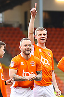 Scottish stag Kevin Stuart who was made mascot by his friends during his stag do in Blackpool walks out with Jay Spearing of Blackpool FC during the Sky Bet League 1 match between Blackpool and Bradford City at Bloomfield Road, Blackpool, England on 7 April 2018. Photo by Thomas Gadd.