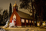 Idaho, North, Coeur d'Alene. Fort Sherman Chapel, built in 1880 is a historic landmark in the Fort Grounds district of Coeur d'Alene. Seen here on a winter night with snow.