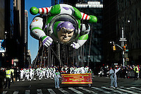 USA, New York, Nov 28, 2013. A Buzz Lightyear balloon floats while people take part in the 87th Macy's Thanksgiving Day Parade in New York City. Photo by VIEWpress/Eduardo Munoz Alvarez