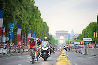 Greg Van Avermaet (BEL/BMC) tries to outrun the peloton over the Champs-&eacute;lys&eacute;es with Svein Tuft (CAN/Orica-GreenEDGE) &amp; Jens Voigt (DEU/Trek Factory Racing) in tow.<br /> <br /> 2014 Tour de France<br /> stage 21: Evry - Paris Champs-Elys&eacute;es (137km)