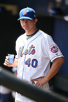 April 12, 2009:  Pitcher Scott Shaw (40) of the St. Lucie Mets, Florida State League Class-A affiliate of the New York Mets, in the dugout during a game at Tradition Field in St. Lucie, Florida.  (Mike Janes/Four Seam Images via AP Images)