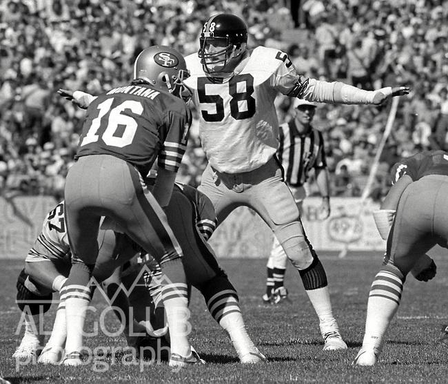 San Francisco 49ers vs. Pittsburgh Steelers at Candlestick Park Sunday, October 14, 1984..Steelers beat the 49ers 20-17.San Francisco Quarterback Joe Montana (16) and Pittsburgh Steelers Linebacker Jack Lambert (58)..