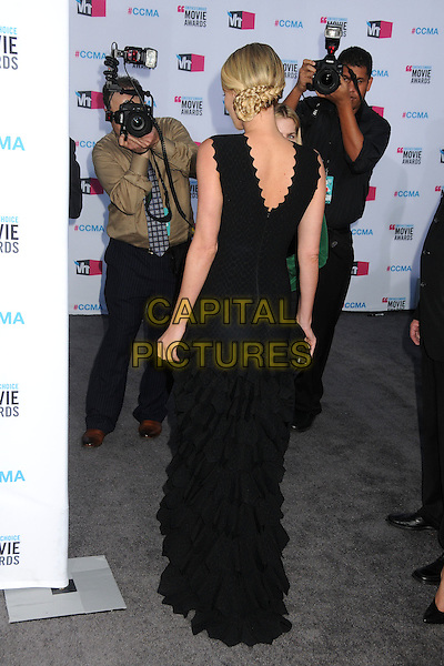 Charlize Theron.17th Annual Critics Choice Movie Awards - Arrivals held at the Hollywood Palladium,  Los Angeles, California, USA, 12th January 2012..arrivals full length long maxi dress scallop edge trim black tiered clutch bag back rear behind .CAP/ADM/BP.©Byron Purvis/AdMedia/Capital Pictures.