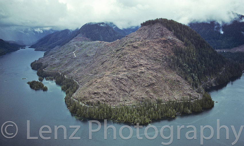 "Yaky Kop Cone, Quatsino Inlet, Vancouver Island. B.C.  In the early 1990's, as an attempt to counter growing international criticism of logging practices in B.C., the government brought in logging guidelines. Seen hear is a ""Scenic Fringe"" as part of the Government's ""Visual Quality Objectives."""