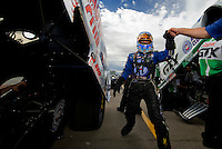 Oct. 31, 2008; Las Vegas, NV, USA: NHRA funny car driver Robert Hight high fives a crew member during qualifying for the Las Vegas Nationals at The Strip in Las Vegas. Mandatory Credit: Mark J. Rebilas-