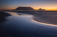 View of Cape Town City and its iconic Table Mountain as seen from Sunset Beach, Table View