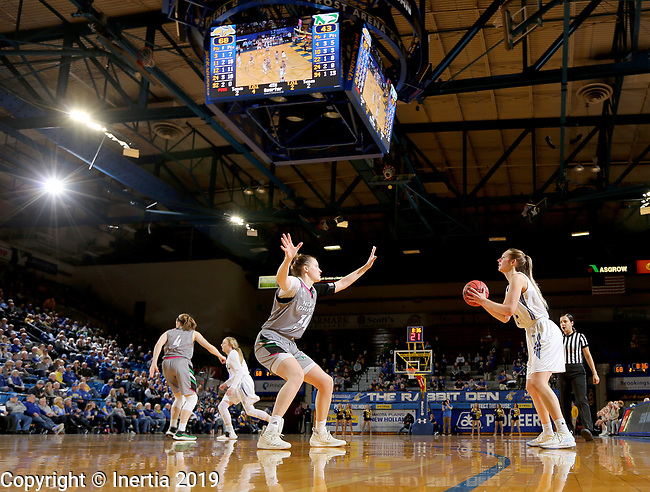 BROOKINGS, SD - FEBRUARY 9: Tagyn Larson #24 from South Dakota State University eyes a three pointer against Lexi Klabo #34 from the University of North Dakota during their game Saturday at Frost Arena in Brookings, SD. (Photo by Dave Eggen/Inertia)