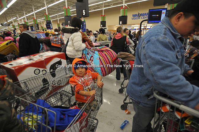 "Shoppers crowd a Wal-mart at 5 A.M. in the northwest Chicago suburb of Niles, Ill. on November 28, 2008, the day after Thanksgiving on the retail shopping spree day known as ""Black Friday."" Despite the recession and economic downturn, shoppers still rose early and flocked to big ticket items like flat screen televisions, a popular item at the Wal-mart in Niles."